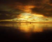 Den guld- solnedgången Arkivbild