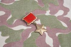 Den guld- stjärnamedaljen är en special gradbeteckning som identifierar mottagare av titelhjälten i Sovjetunionenet på sovjetisk  royaltyfri bild