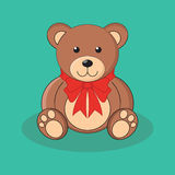 Den gulliga bruna nallebjörnen leker med den röda pilbågen Royaltyfri Bild