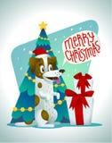 Den gulliga hunden med feriegåvor och anförande bubblar säga glad jul Stilfull hund för stålarrussell terrier på bakgrunden Royaltyfri Bild