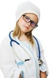 Den gulliga liten flicka leker doktorn royaltyfri foto
