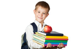 Den gulliga pojken är det holdingböcker och äpplet. isolerat Fotografering för Bildbyråer
