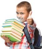 Den gulliga pojken rymmer boken Royaltyfri Bild