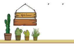 Den hängningträ och kaktuns dekorerar Arkivbilder