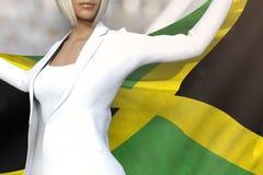 Den härliga affärsdamen rymmer den Jamaica flaggan i händer bak hennes baksida på kontorsbyggnadbakgrunden - flaggabegreppet 3d royaltyfri fotografi