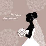 Den härliga bruden med snör åt på en grå bakgrund Royaltyfri Fotografi