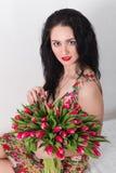 den härliga buketten blommar kvinnabarn Royaltyfri Foto