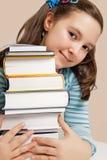 Den härliga flickan med bokar Royaltyfria Foton