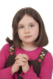 Den härliga flickan som ber med öppet, synar Royaltyfria Bilder