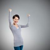 Den härliga flickan som göra en gest ja, är lycklig Arkivfoto