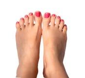 Den härliga foten med den perfekta brunnsorten spikar pedikyr på vit bakgrund Royaltyfri Foto