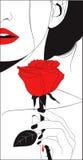 Den härliga kvinnan sårade vid en tagg av en röd ros Royaltyfria Foton