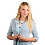 Den härliga le affärskvinnaståenden på en vit bakgrund Arkivfoton