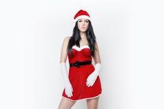 Den härliga och sexiga kvinnan klär som ett sexiga Santa Claus Arkivbild