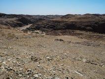 Den härliga platsen av vaggar bakgrund för panorama för bergtexturlandskapet av unik geografi för den Namib öknen med den blixtra royaltyfria foton