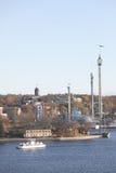 Den härliga Skeppsholmenen och nöjesfältet Grona Lund in Fotografering för Bildbyråer