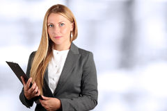 Den härliga ståenden för affärskvinna Arkivfoto