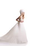 Den härliga unga kvinnan i en bröllopsklänning Royaltyfri Bild