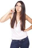Den härliga unga kvinnan som borras med ditt, ringer arkivfoton