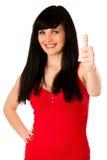 Den härliga unga kvinnan som gör en gest framgångvisning, tummar upp Royaltyfria Foton