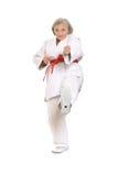 Den höga kvinnan i karate poserar Royaltyfria Foton