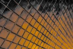Den h?rliga closeupen texturerar abstrakta tegelplattor och svart gul f?r f?rgexponeringsglasmodell f?r v?gg bakgrund f?r guld oc royaltyfri foto