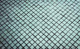 Den h?rliga closeupen texturerar abstrakta tegelplattor och vit f?rgglasv?ggbakgrund f?r den silver och och modellen royaltyfria foton
