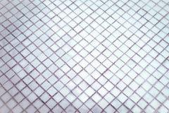 Den h?rliga closeupen texturerar abstrakta tegelplattor och vit f?rgglasv?ggbakgrund f?r den silver och och modellen arkivfoton