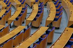 Empty plenary hall of the House of Representatives seen from the public stand where the journalists and general public reside royalty free stock image