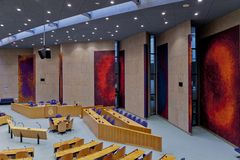 View of interior of the empty plenary hall of the House of Representatives focused on the place where the ministers sit to answer stock images
