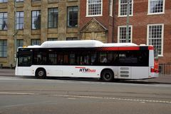 Dutch HTMbuzz public service bus. Den Haag, Netherlands - May 19, 2018: Dutch HTMbuzz public service bus parked by the side of the road royalty free stock photo