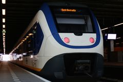 Den Hague, the Netherlands, February 15, 2019: The back view of a white train sprinter from the ns stock image