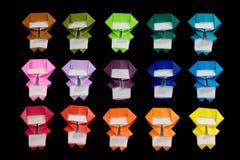 Den handgjorda origamin Ninja Kids på den svarta bakgrunden Royaltyfria Foton