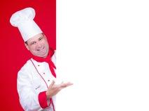 Den Head kocken erbjuder en meny Arkivfoton