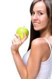 Den Healthful äta-härliga naturliga kvinnan rymmer ett äpple Arkivfoto