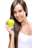 Den Healthful äta-härliga naturliga kvinnan rymmer ett äpple Arkivbild