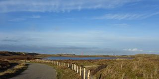 Den Helder panorama. Wide panoramic view across the nature preserve along the North Sea dune coast of Den Helder, the Netherlands. Only a little more than an stock photography