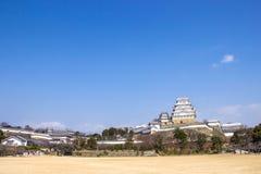 Den Himeji slotten under tid för körsbärsröd blomning ska blomma i den Hyogo prefekturen, Japan royaltyfri bild