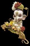 Den hinduiska guden Ganesha och tjaller Fotografering för Bildbyråer