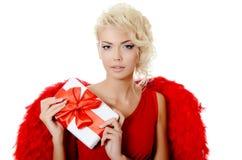 Den härliga flickan i en dräkt av en röd ängel Royaltyfri Bild