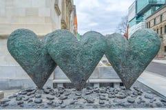 Den iconic skulpturen av Twin 6' hjärtor arkivbild