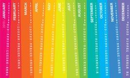 Den idérika väggkalendern 2019 med den ojämna vertikala regnbågedesignen, söndagar valde, det engelska språket stock illustrationer