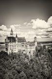 Den idylliska Neuschwanstein slotten fotografering för bildbyråer