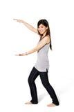 den ifrån varandra asiatiska flickan hands bred wih Arkivfoto