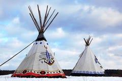 den indiska infödingen kissar utslagsplatsen Arkivfoto