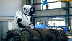 Den industriella mekanismen borras av en cyborg stock video