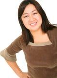 den isolerade asiatiska flickan poserar arkivbild