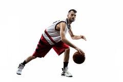 Den isolerade basketspelaren i handling flyger royaltyfria bilder