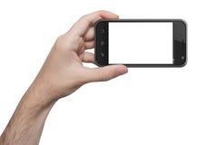 Den isolerade kvinnahanden som rymmer telefonen, isolerade skärmen arkivfoto