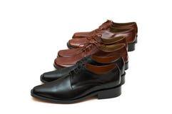 den isolerade male raden shoes white Fotografering för Bildbyråer